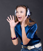Music bright girl with headphones — Stock Photo