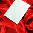 Blank card on red silk — Stock Photo #6797070