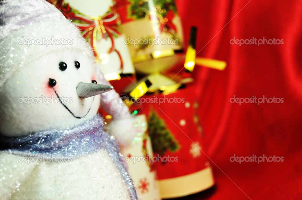 Abstract Christmas background with snowman and crackers against red silk  — Stock Photo #6796889