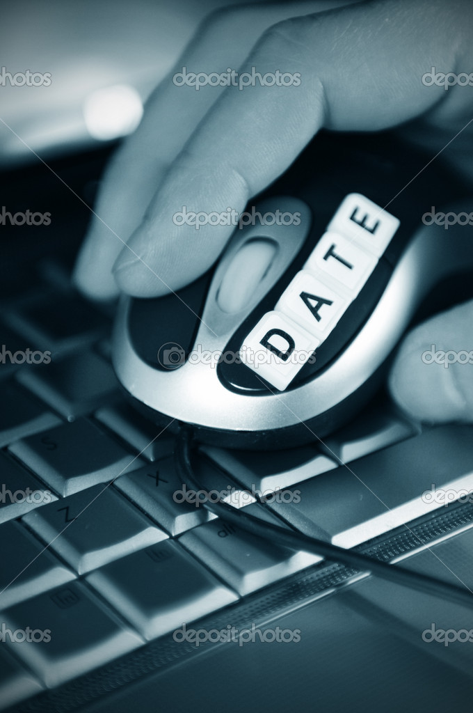 Online dating concept with hand holding mouse — Stock Photo #6827966