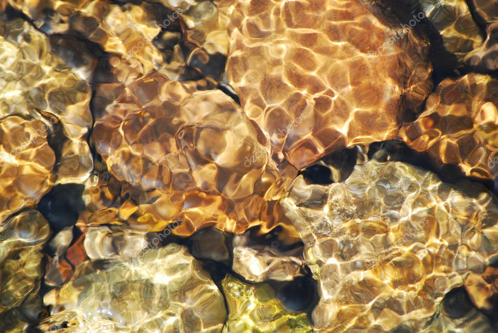 Clear water and rocks texture suitable as background  — Stock Photo #7218441