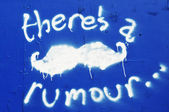 Rumor graffiti — Stock Photo