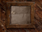 Vintage classical frame on wooden background — Stock Photo