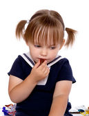 The little girl eats a chocolate — Stock Photo