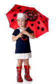 The little girl with an umbrella and in rubber boots — Stock Photo