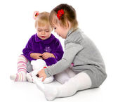Two girls play with a teddy bear — Stock Photo