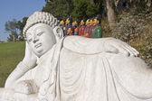 Buddha with terracotta warriors — Stock Photo
