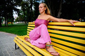Girl on a bench — Stock Photo