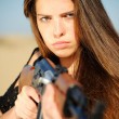 Stock Photo: Girl aiming machine gun