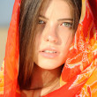 Stock Photo: Girl in colored cloak