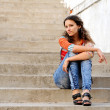 Girl on the old stairs — Stock Photo