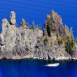 Stock Photo: Phantom Ship Island Blue Crater Lake Reflection White Boat Orego
