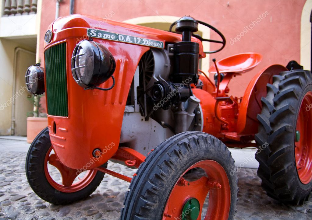 Old model of tractor, renovated to be in superb condition  Stock Photo #6944529