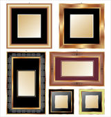 Set of golden and classical picture frames for your individual content — Stock Vector