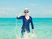 Stylish man in the sea — Stock Photo