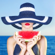 Young lady at sea with watermelon — Stock Photo