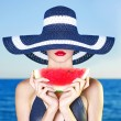 Stock Photo: Young lady at sea with watermelon