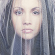 Beautiful young woman under a veil - Stock Photo