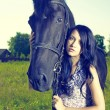 Beautiful young woman and horse — Stock Photo