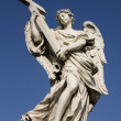 Statue of an angel on the Sant Angelo Bridge in Rome - Stock Photo