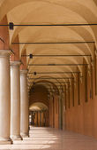 Medieval portico with columns in Bologna — Stock Photo