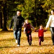 Young family in the autumn park — Stock Photo #6860146