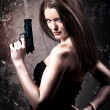 Woman with a gun — 图库照片