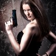 Woman with a gun - Stock Photo