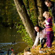 Young family in the autumn park — Foto de stock #7087870