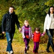 Young family in the autumn park — Stock Photo #7087888