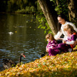 Young family in the autumn park — Stock fotografie
