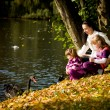 Young family in the autumn park — ストック写真