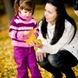 Little girl in the autumn park — Stock Photo #7631272