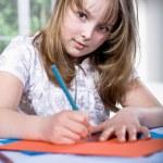 Drawing schoolgirl — Stock Photo #7841222