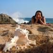 Stock Photo: Young womat beach and seashell