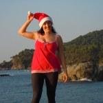Playful santa´s helper by the sea — Stock Photo