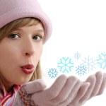 Girl with snowflake — Stock Photo