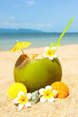 Ocean beach with palm and and coctail — Stock Photo