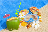 Ocean beach with palms and and coctail — Stock Photo