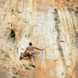 The rock-climber during rock conquest — Stock Photo #7315438