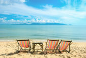 Chairs on the beautiful sandy beach near sea — Stock Photo