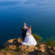 Stock Photo: Bride and groom near the sea