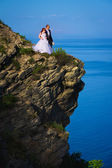 Bride and groom near the sea — Stock Photo