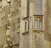 Windows and sculptures on a castle wall — Stock Photo