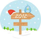 Puntatore 2012 con cappello di natale e uccello — Vettoriale Stock