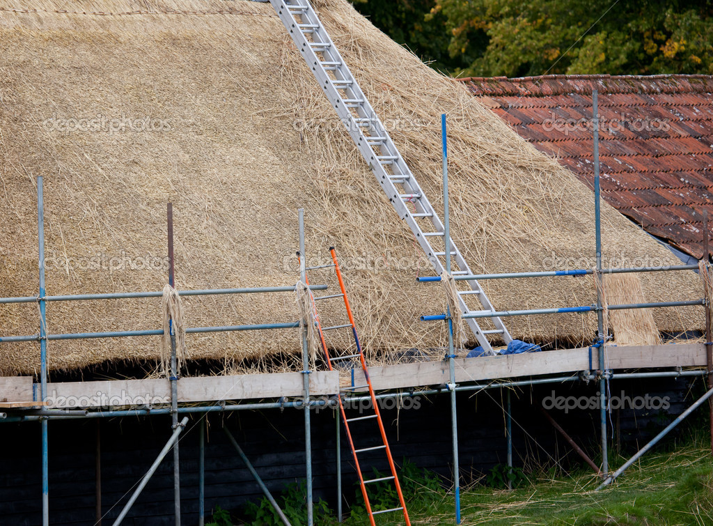 Photo of a roof being rethatched — Stock Photo #6830373