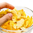 Hand grabbing chips — Stock Photo #7151696