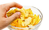 Hand grabbing chips — Stock Photo