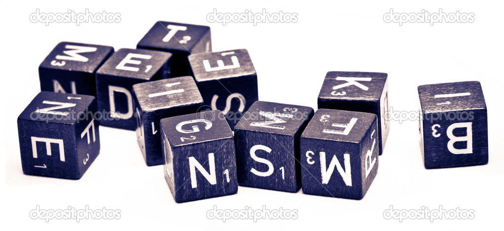 Letters on some dices on a white background — Stock Photo #7163320