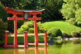 Japanese Garden and pond with a red Zen Tower. — Stock Photo
